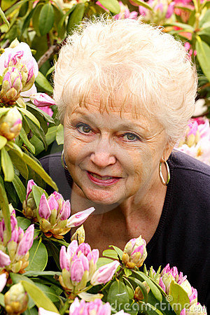 Portrait of a Pretty Older Lady in Her Flowers