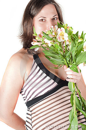 Portrait of pretty pregnant woman with flowers