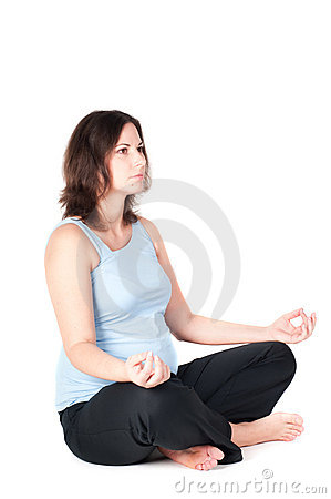 Portrait of pretty pregnant woman practicing yoga