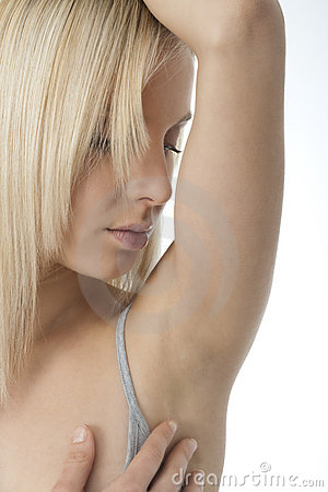 Portrait of pretty woman looking her clean armpit