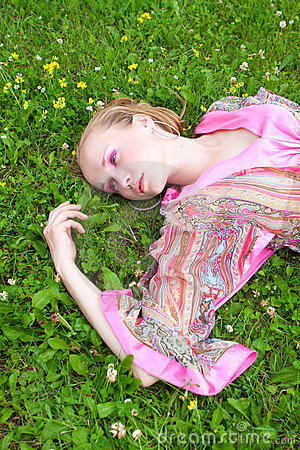 Portrait of a pretty  woman on the meadow