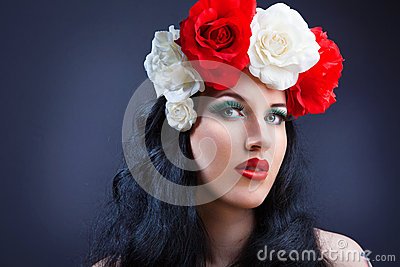 Portrait of pretty young girl with roses.