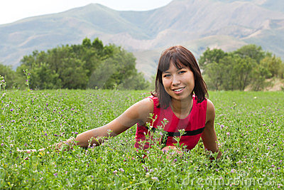 Portrait of pretty young lady on a meadow