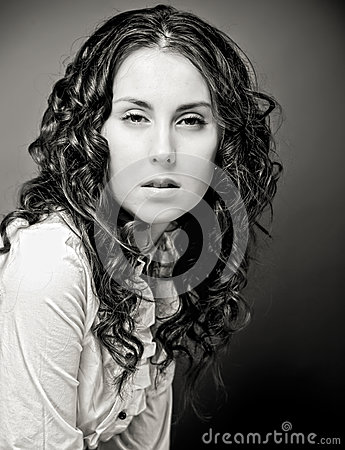 Portrait of pretty young woman with curly hair.
