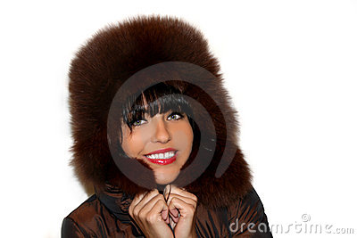 Portrait of a pretty young woman in a furry hat