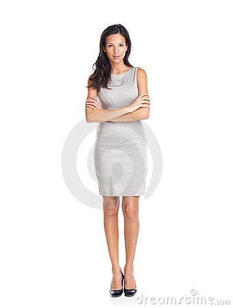 Portrait of a pretty young woman standing on white