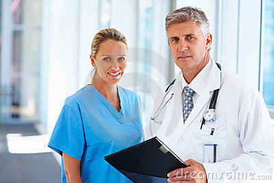 Portrait of professional doctors standing together