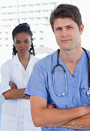 Portrait of professional doctors standing up