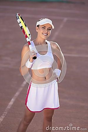 Portrait of Professional female Tennis Player Wearing White Spor
