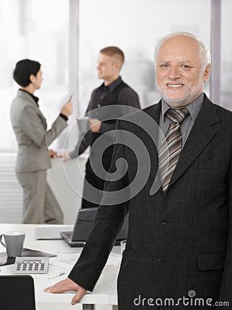 Portrait of proud senior executive in office