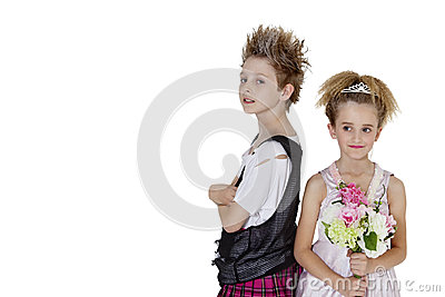 Portrait of punk boy with bridesmaid holding flower bouquet over white background