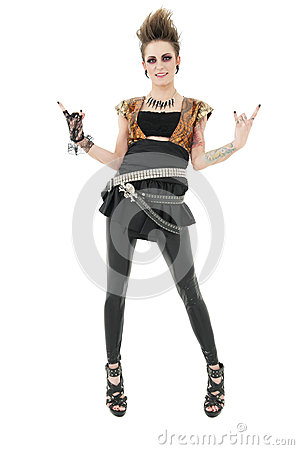 Portrait of punk woman gesturing rock sign over white background