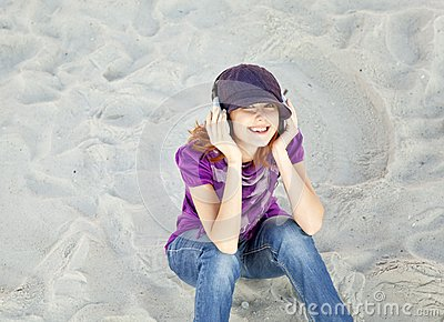 Portrait of red-haired girl with headphone