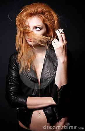 Portrait of redhead woman with a cigarette