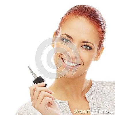 Portrait of a redhead woman holding a car key
