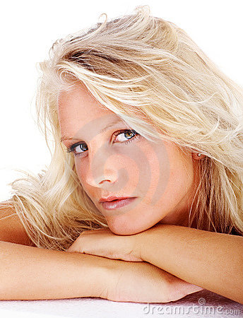 Portrait of a relaxed blond female over white