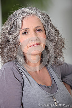 Relaxed gray-haired woman