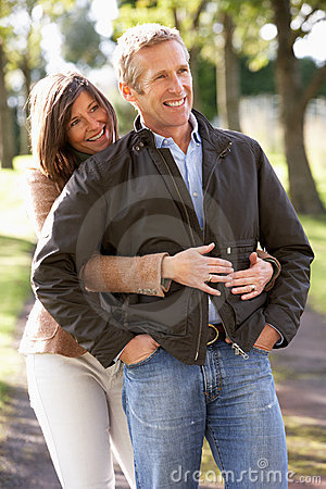 Portrait Of Romantic Couple Enjoying Outdoor Walk