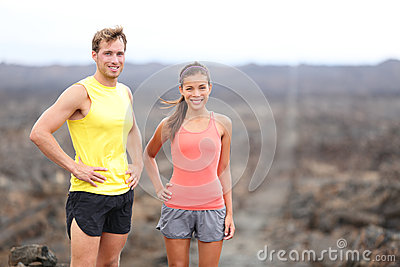 Portrait of runner couple resting after running