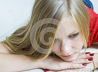 Portrait of sad beautiful young girl