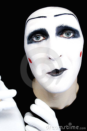 Portrait of  sad mime in white gloves