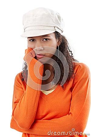 Portrait of sad woman in cap