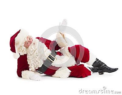 Portrait Of Santa Claus Gesturing While Lying On Floor