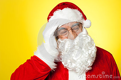 Portrait of Santa Claus suffering from headache