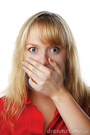 Portrait of scared woman covering mouth with hand