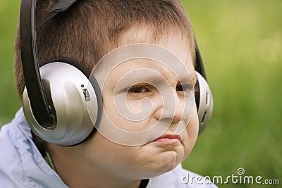Portrait of sceptic boy in headphones