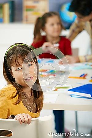 Portrait of schoolgirl in art class