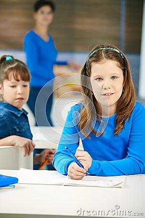 Portrait of schoolgirl in class