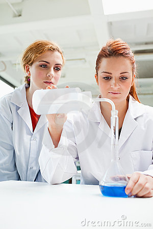 Portrait of scientists doing an experiment