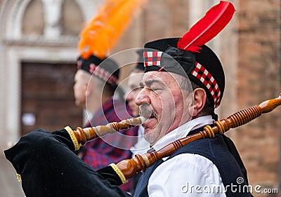 Portrait of a Scottish Bagpiper Editorial Photo
