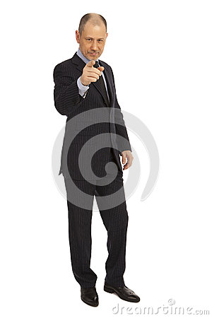 Portrait of senior business man pointing at you against white background.