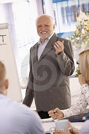 Portrait of senior businessman doing presentation