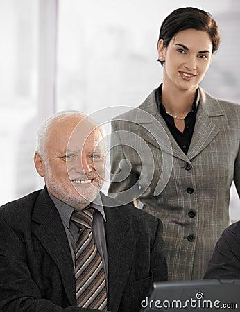 Portrait of senior businessman with partner