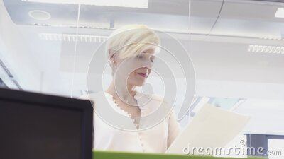 Portrait of senior businesswoman smiling in office stock footage