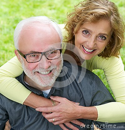 Portrait of a senior couple smiling together outdoors