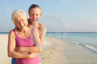 Portrait Of Senior Couple On Tropical Beach Holiday