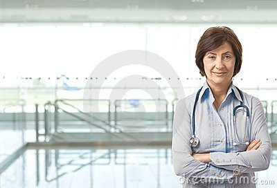 Portrait of senior female doctor on corridor
