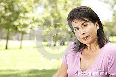 Portrait Of Senior Hispanic Woman In Park