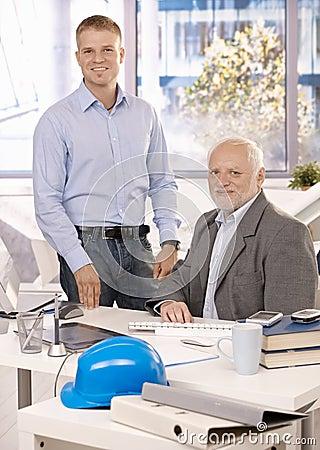 Portrait of senior and junior businessmen