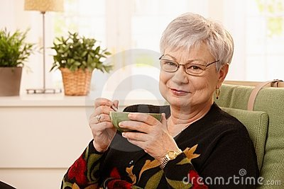Portrait of senior lady drinking tea