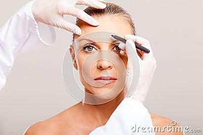 Senior woman face marking
