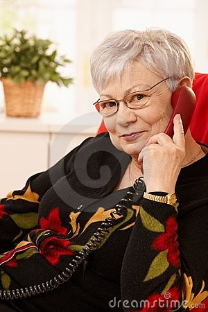 Portrait of senior woman on phone call