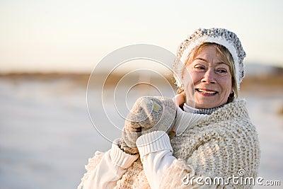 Portrait of senior woman in warm winter clothing