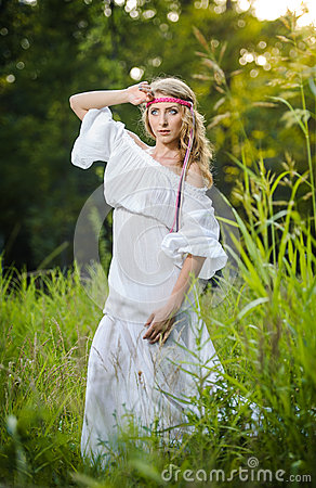 Portrait of a sensual young blonde female on field