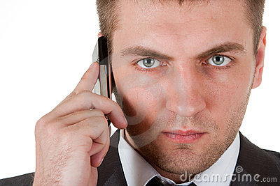 Portrait of serious businessman with phone