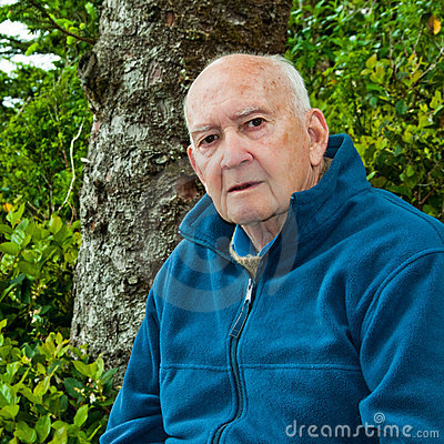 Portrait of Serious Senior Man Outdoors in Forest